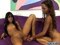 Ebony lesbians fucking with dildo
