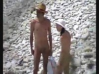 Nude Couple Romping On The Beach