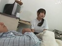 Kinky japanese nurse taking care of patient