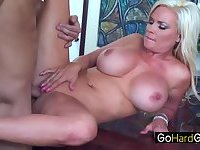Blonde milf was fucked on the table