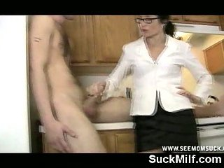 Milf with glasses gives blowjob in kitchen
