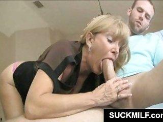 Blonde MILF gives oral sex