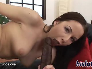 Naughty slut masturbates with a huge toy